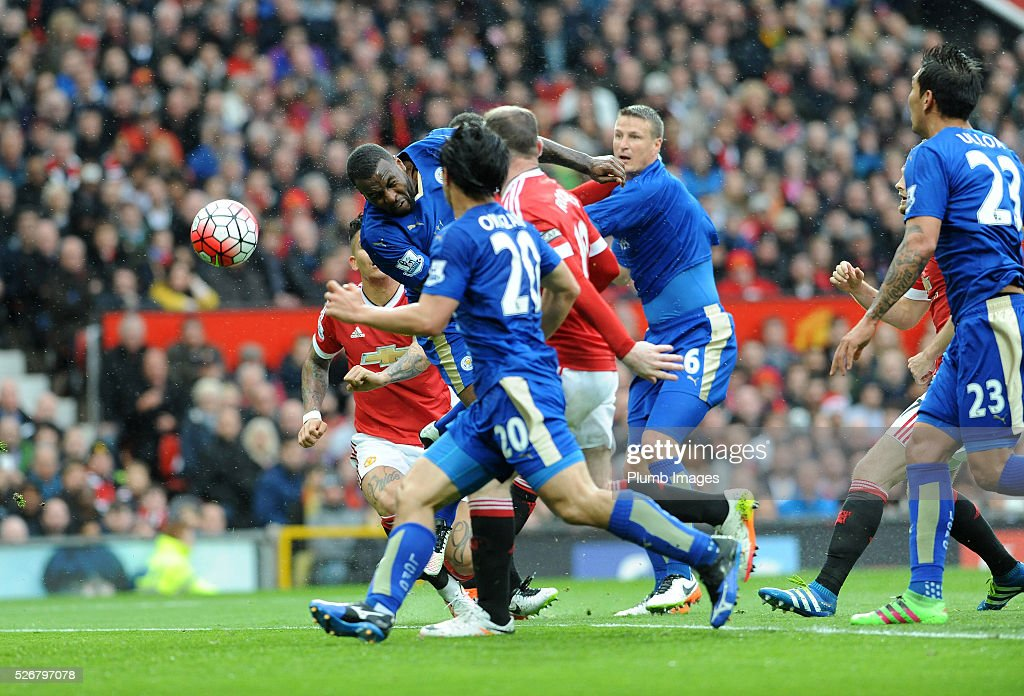 <a gi-track='captionPersonalityLinkClicked' href=/galleries/search?phrase=Wes+Morgan+-+Soccer+Player&family=editorial&specificpeople=13491493 ng-click='$event.stopPropagation()'>Wes Morgan</a> of Leicester City scores to make it 1-1 during the Premier League match between Manchester United and Leicester City at Old Trafford on May 01, 2016 in Manchester, United Kingdom.