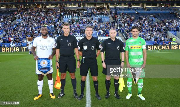 Wes Morgan of Leicester City with Lars Stindl of Borussia Monchengladbach at King Power Stadium ahead of the Leicester City v Borussia...