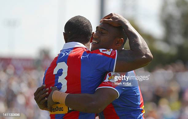 Wes Naiqama and Akuila Uate of the Knights Knights celebrate after Akuila Uate of the Knights scored a try during the round two NRL match between the...