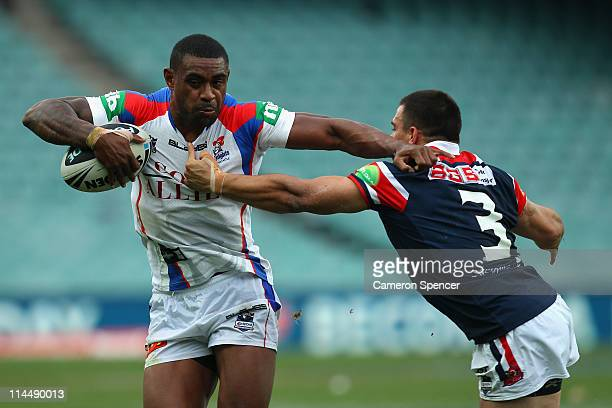 Wes Naiqama of the Knights is tackled during the round 11 NRL match between the Sydney Roosters and the Newcastle Knights at the Sydney Football...