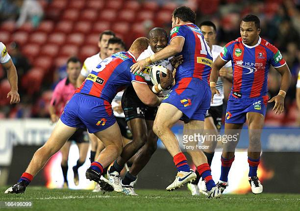 Wes Naiqama of the Panthers is tackled by the Knights defence during the round six NRL match between the Newcastle Knights and the Penrith Panthers...