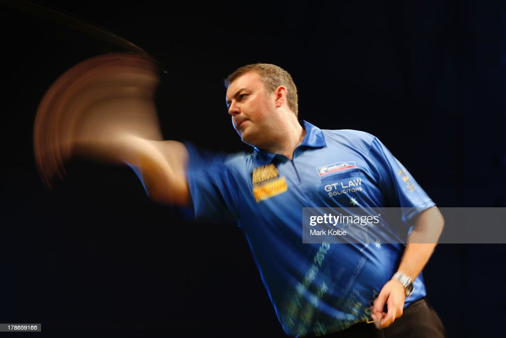 Wes Newton of England in action during his quarter-final match against Adrian Lewis of England during day two of the Sydney Darts Masters at Luna Park on August 30, 2013 in Sydney, Australia.