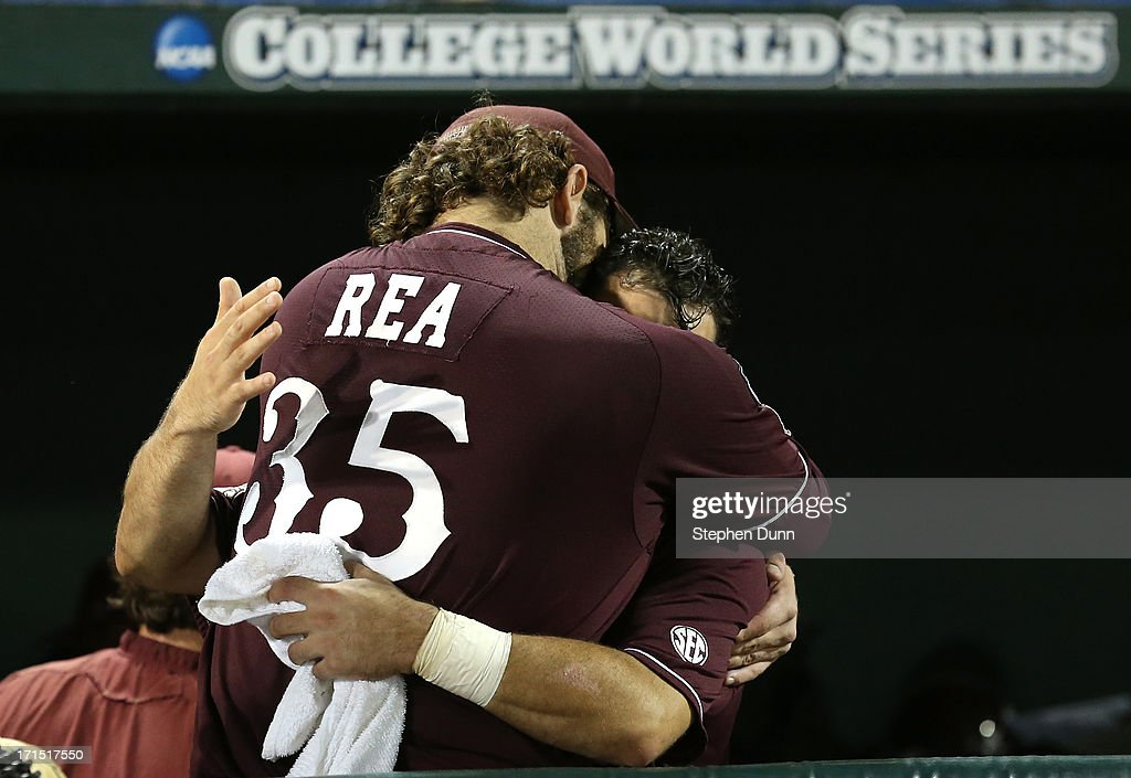 Wes Rea #35 and Nick Ammirati #17 of the Mississippi State Bulldogs embrace after losing to the UCLA Bruins during game two of the College World Series Finals on June 25, 2013 at TD Ameritrade Park in Omaha, Nebraska. UCLA won 8-0 to take the series two games to none and win the College World Series Championship.