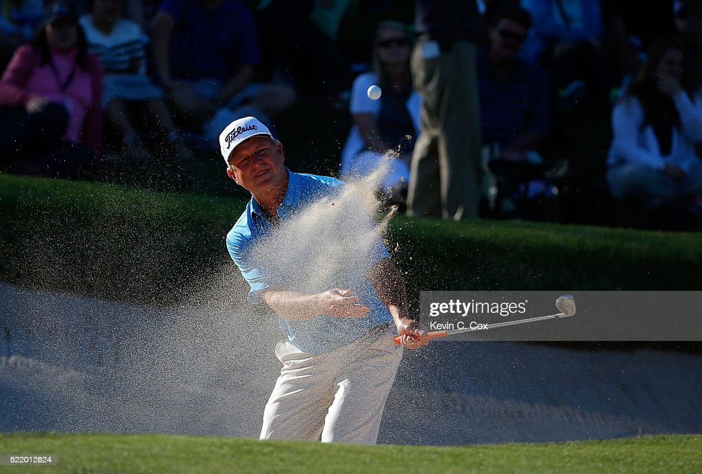 Wes Short Jr chips out of the sand onto the 18th green during the final round of the Mitsubishi Electric Classic at TPC Sugarloaf on April 17 2016 in...