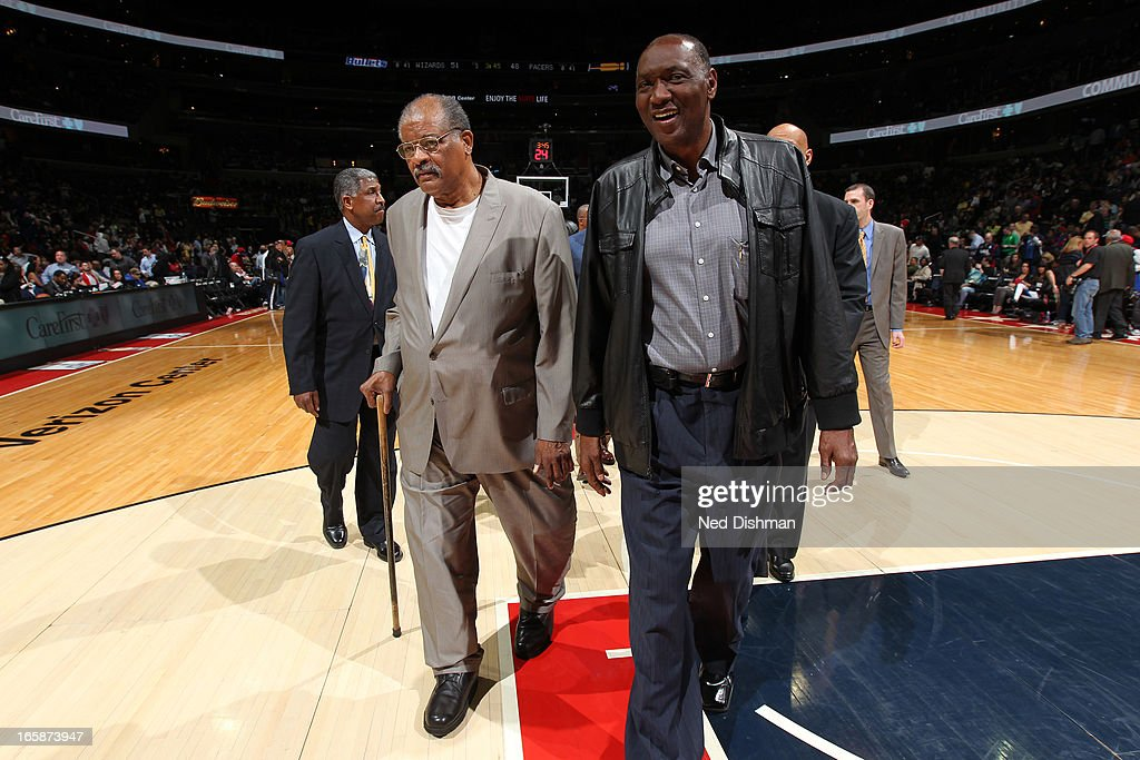 <a gi-track='captionPersonalityLinkClicked' href=/galleries/search?phrase=Wes+Unseld&family=editorial&specificpeople=212864 ng-click='$event.stopPropagation()'>Wes Unseld</a> (L) and <a gi-track='captionPersonalityLinkClicked' href=/galleries/search?phrase=Elvin+Hayes&family=editorial&specificpeople=208869 ng-click='$event.stopPropagation()'>Elvin Hayes</a> (R) from the 1977-78 NBA World Champion Washington Bullets walk onto the court in front of the crowd prior to the game at the Verizon Center on April 6, 2013 in Washington, DC.