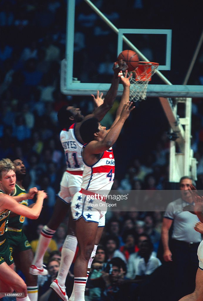 Wes Unseld and Elvin Hayes of the Washington Bullets goes up for a rebound against the Seattle Supersonics during an NBA basketball game circa 1978...