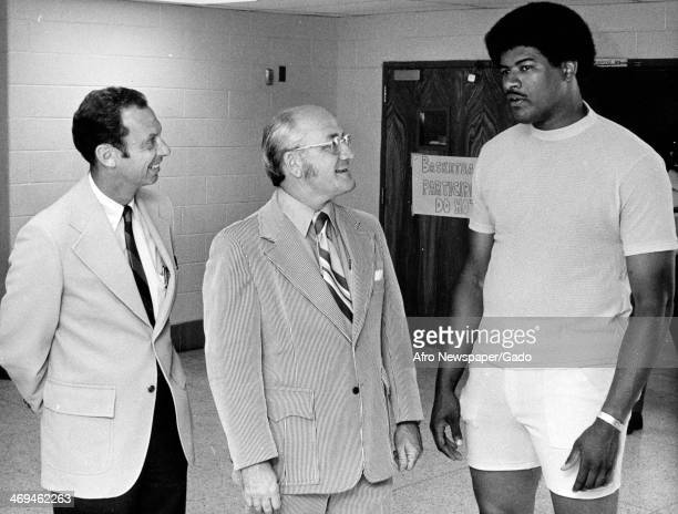 Wes Unseld basketball player with Baltimore Bullets speaks to two men at the Hoops Clinic 1980