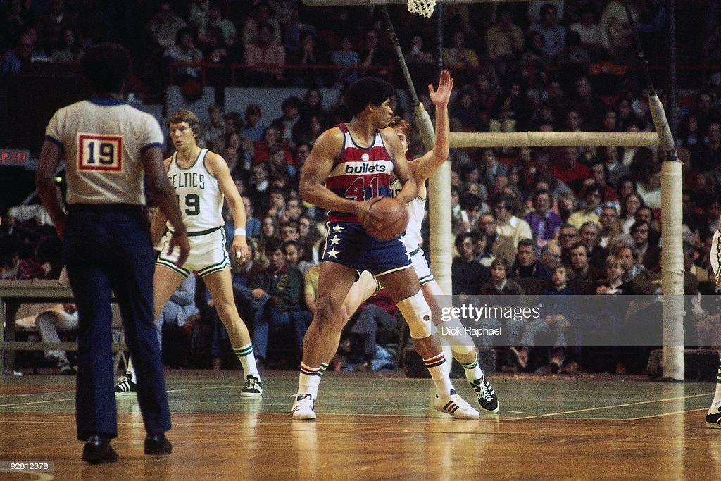 <a gi-track='captionPersonalityLinkClicked' href=/galleries/search?phrase=Wes+Unseld&family=editorial&specificpeople=212864 ng-click='$event.stopPropagation()'>Wes Unseld</a> #41 of the Washington Bullets posts up against the Boston Celtics during a game played in 1974 at the Boston Garden in Boston, Massachusetts.