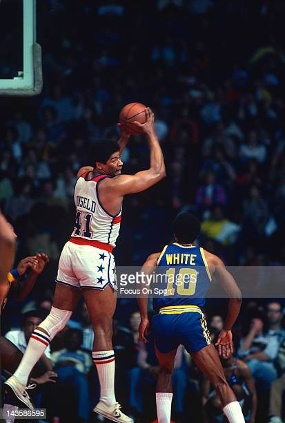Wes Unseld of the Washington Bullets pulls down a rebound over Jo Jo White of the Golden State Warriors during an NBA basketball game circa 1979 at...