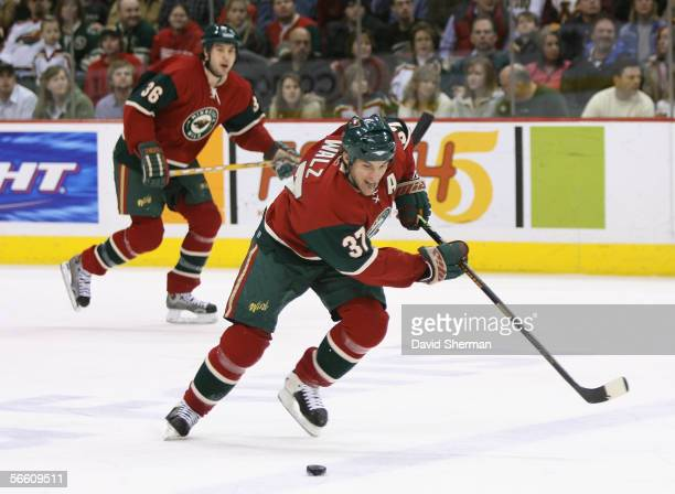 Wes Walz of the Minnesota Wild skates with the puck against the Vancouver Canucks during the NHL game on December 31 2005 at the Xcel Energy Center...