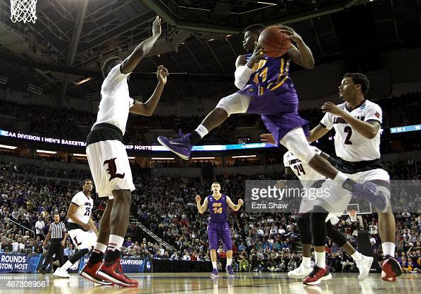 Wes Washpun of the Northern Iowa Panthers shoots the ball in the first half of the game against the Louisville Cardinals during the third round of...