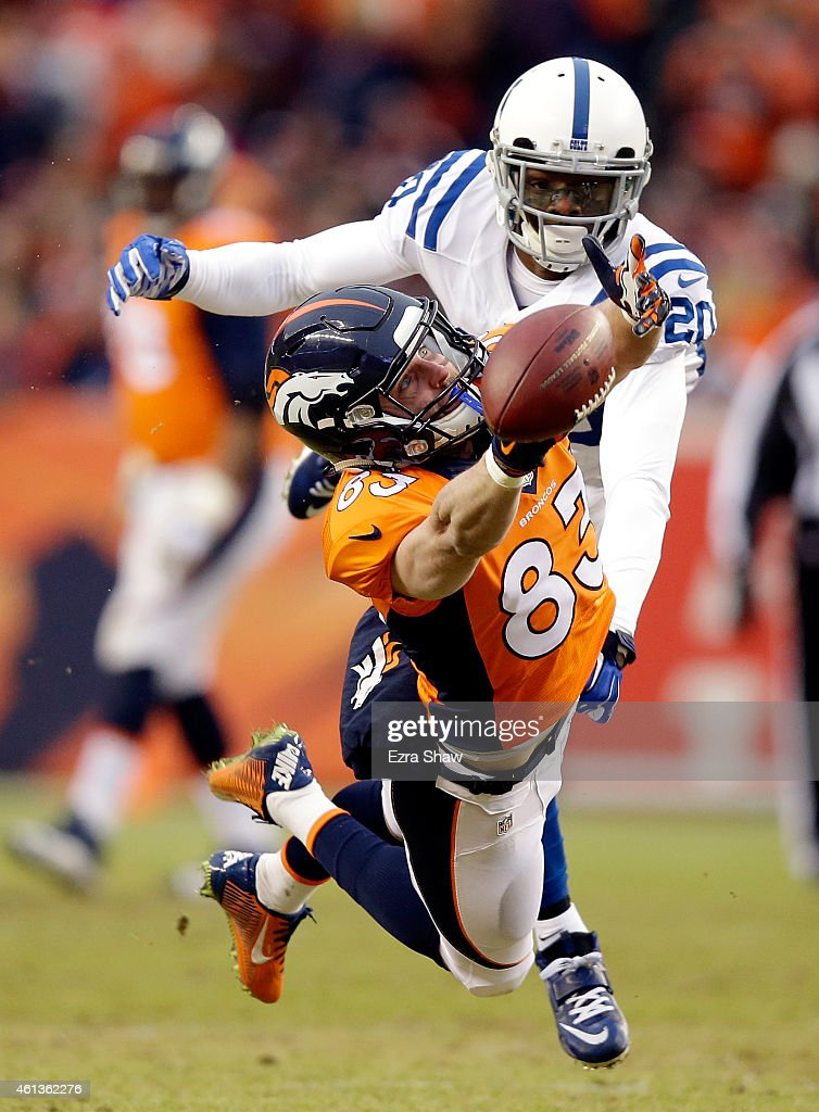 Wes Welker #83 of the Denver Broncos attempts to make a catch as Darius Butler #20 of the Indianapolis Colts defends during a 2015 AFC Divisional Playoff game at Sports Authority Field at Mile High on January 11, 2015 in Denver, Colorado.