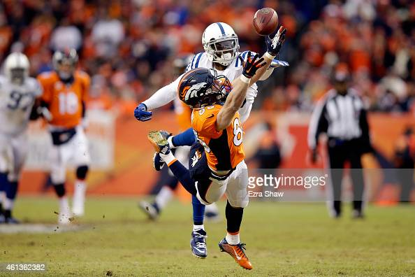 Wes Welker of the Denver Broncos attempts to make a catch as Darius Butler of the Indianapolis Colts defends during a 2015 AFC Divisional Playoff...