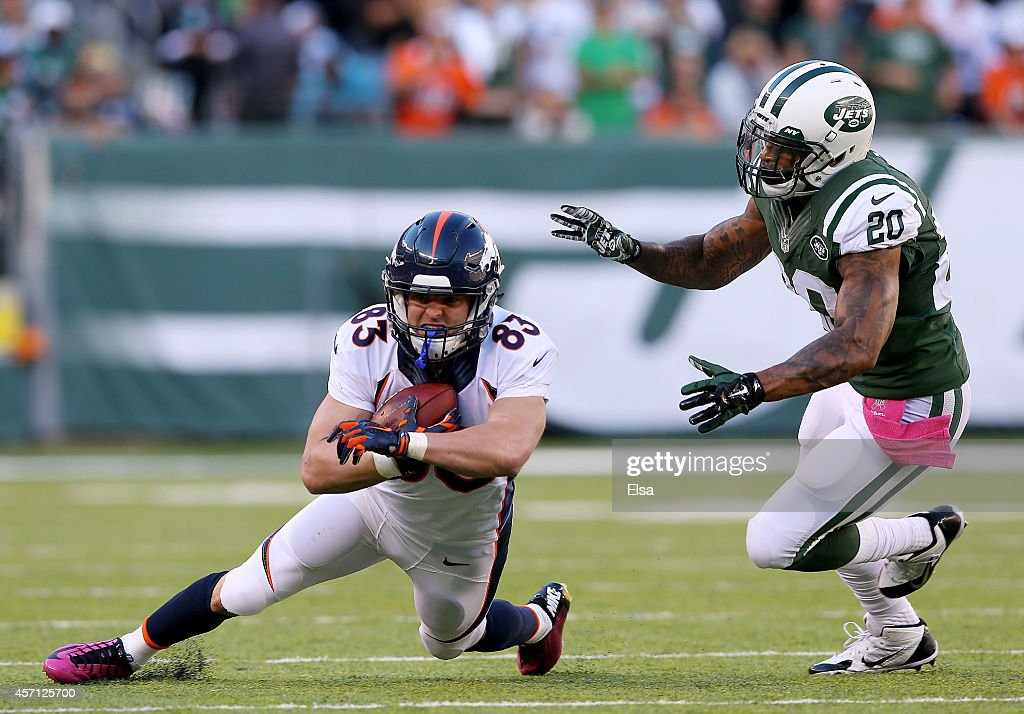 Wes Welker #83 of the Denver Broncos carries the ball as Kyle Wilson #20 of the New York Jets defends on October 12, 2014 at MetLife Stadium in East Rutherford, New Jersey.
