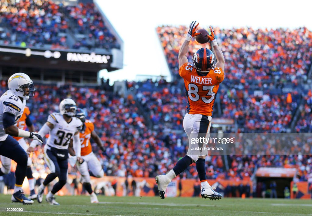 <a gi-track='captionPersonalityLinkClicked' href=/galleries/search?phrase=Wes+Welker&family=editorial&specificpeople=236127 ng-click='$event.stopPropagation()'>Wes Welker</a> #83 of the Denver Broncos completes a second quarter touchdown pass against the San Diego Chargers during the AFC Divisional Playoff Game at Sports Authority Field at Mile High on January 12, 2014 in Denver, Colorado.