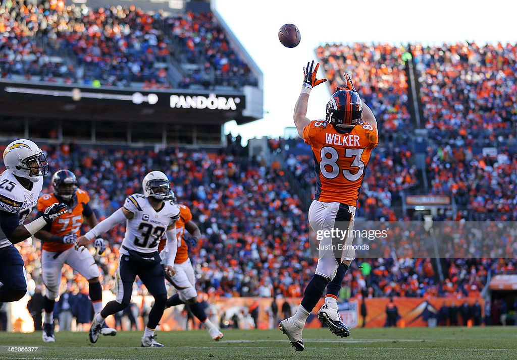 Wes Welker #83 of the Denver Broncos completes a second quarter touchdown pass against the San Diego Chargers during the AFC Divisional Playoff Game at Sports Authority Field at Mile High on January 12, 2014 in Denver, Colorado.