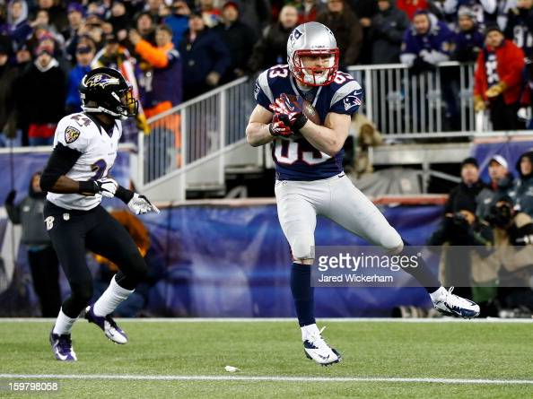 Wes Welker of the New England Patriots catches a touchdown pass in the second quarter against Corey Graham of the Baltimore Ravens during the 2013...
