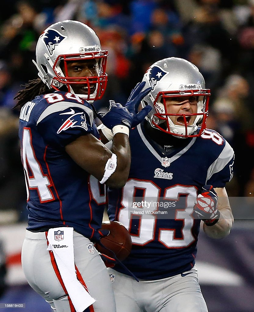 Wes Welker #83 of the New England Patriots celebrates with teammate Deion Branch #84 of the New England Patriots after scoring a touchdown in the first quarter against the Miami Dolphins during the game at Gillette Stadium on December 30, 2012 in Foxboro, Massachusetts.