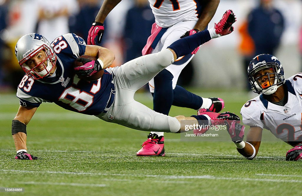 Wes Welker #83 of the New England Patriots is tripped up after catching a pass for the first down by Rahim Moore #26 of the Denver Broncos during the game on October 7, 2012 at Gillette Stadium in Foxboro, Massachusetts.