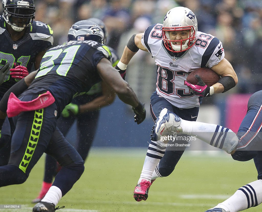 <a gi-track='captionPersonalityLinkClicked' href=/galleries/search?phrase=Wes+Welker&family=editorial&specificpeople=236127 ng-click='$event.stopPropagation()'>Wes Welker</a> #83 of the New England Patriots runs after making a reception as Kam Chancellor #31 moves in for the tackle during a game at CenturyLink Field on October 14, 2012 in Seattle, Washington. The Seahawks beat the Patriots 24-23.