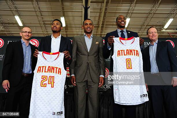 Wes Wilcox Kent Bazemore Grant Hill Dwight Howard and Mike Budenholzer of the Atlanta Hawks speaks during a Press Conference for recent signees...
