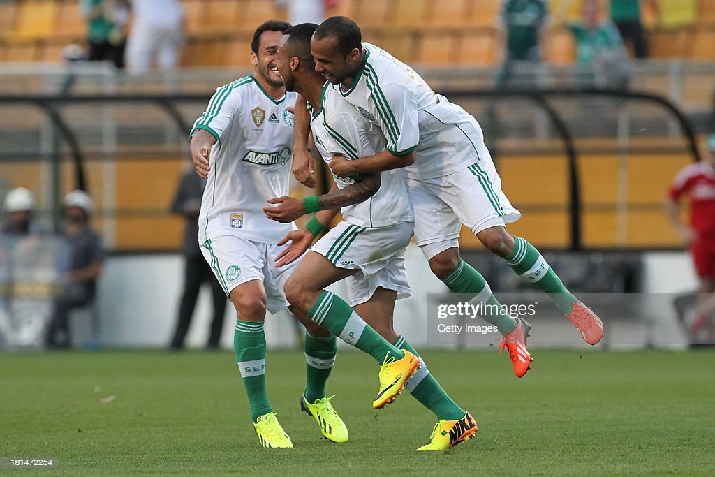 Wesley (C), and teammates from Palmeiras celebrate a scored goal during the match between Palmeiras and Sport for the Brazilian Series B 2013 at Pacaembu stadium on September 21, 2013 in Sao Paulo, Brazil.