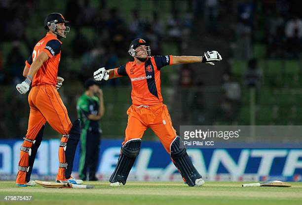 Wesley Barresi of Netherlands and Ben Cooper of Netherlands celebrate after winning the ICC T20 World Cup match between Ireland and Netherlands at...