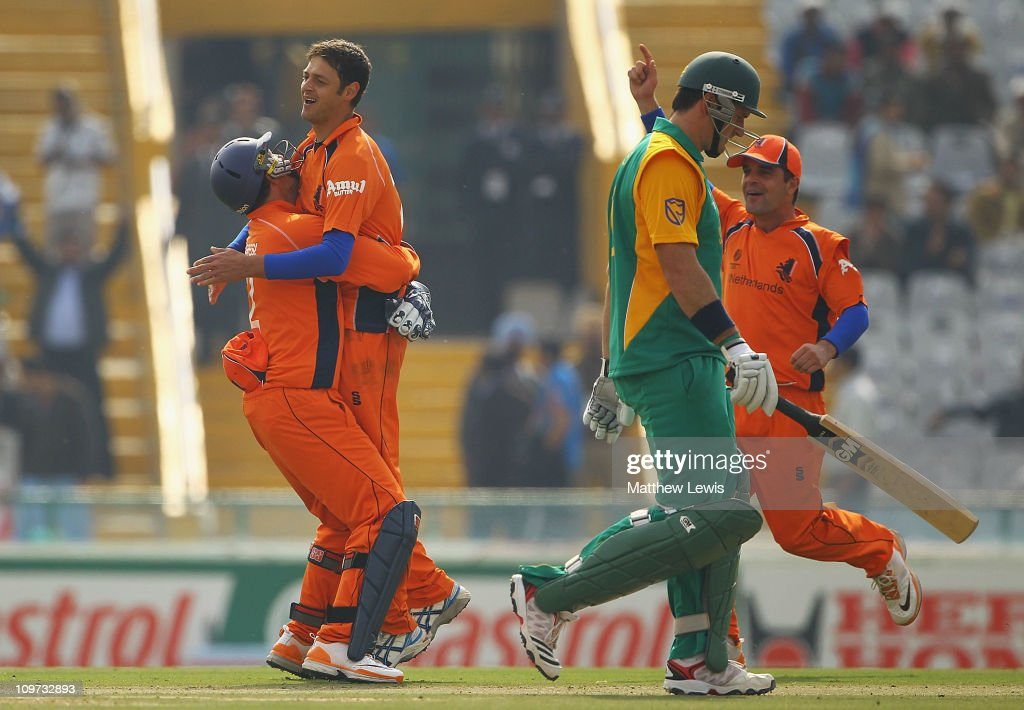 Wesley Barresi of the Netherlands congratulates Bernard Loots, after he bowled <a gi-track='captionPersonalityLinkClicked' href=/galleries/search?phrase=Graeme+Smith+-+Cricket+Player&family=editorial&specificpeople=193816 ng-click='$event.stopPropagation()'>Graeme Smith</a> of South Africa during the 2011 ICC World Cup Group B match between Netherlands and South Africa at Punjab Cricket Association Stadium on March 3, 2011 in Mohali, India.