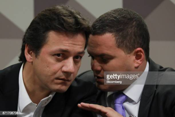 Wesley Batista former chief executive officer of JBS SA left listens while Ticiano Figueiredo attorney for Wesley Batista speaks during a...
