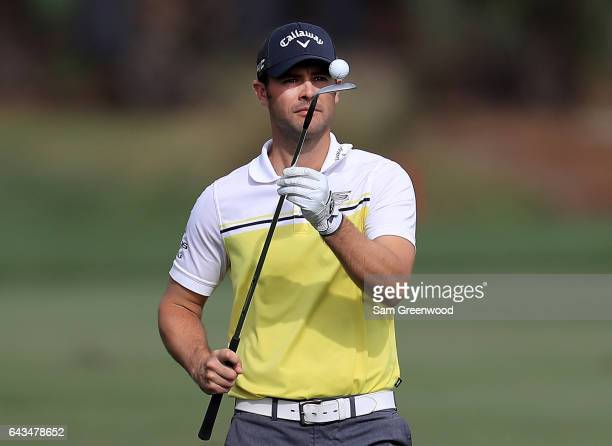 Wesley Bryan balances a ball on the end of his club during a practice round prior to The Honda Classic at PGA National Resort Spa Champions Course on...