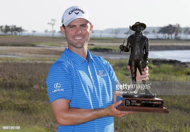 Wesley Bryan celebrates with the trophy after winning the 2017 RBC Heritage at Harbour Town Golf Links during the final round on April 16 2017 in...