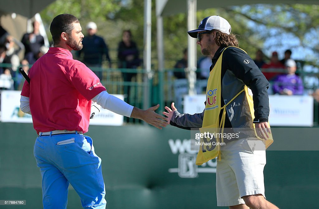 Wesley Bryan is congratulated by his brother and caddie George Bryan IV on the 18th green during the final round of the Chitimacha Louisiana Open...