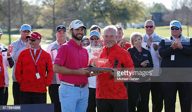 Wesley Bryan is presented with the trophy at the trophy presentation ceremony after the final round of the Chitimacha Louisiana Open presented by...