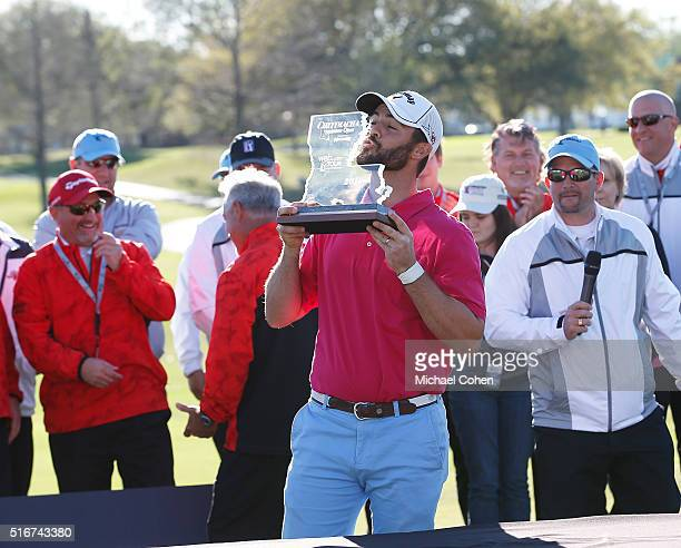 Wesley Bryan kisses the trophy during the presentation ceremony after the final round of the Chitimacha Louisiana Open presented by NACHER held at Le...