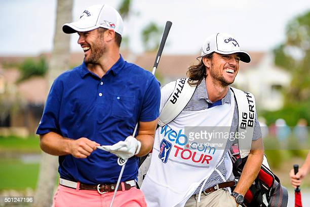 Wesley Bryan left shares a laugh with his caddie and brother George Austin Cook after teeing off on the 12th hole of the Champion Course during the...
