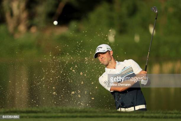 Wesley Bryan of the United States plays a shot from a bunker on the 14th hole during the third round of The Honda Classic at PGA National Resort and...