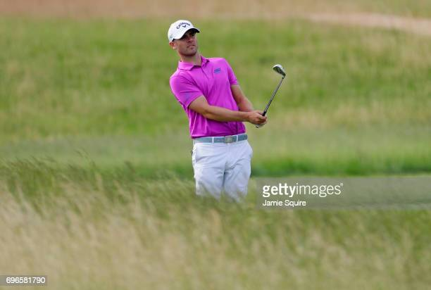 Wesley Bryan of the United States plays a shot on the fourth hole during the second round of the 2017 US Open at Erin Hills on June 16 2017 in...