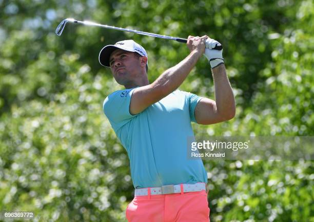 Wesley Bryan of the United States plays his shot from the 16th tee during the first round of the 2017 US Open at Erin Hills on June 15 2017 in...