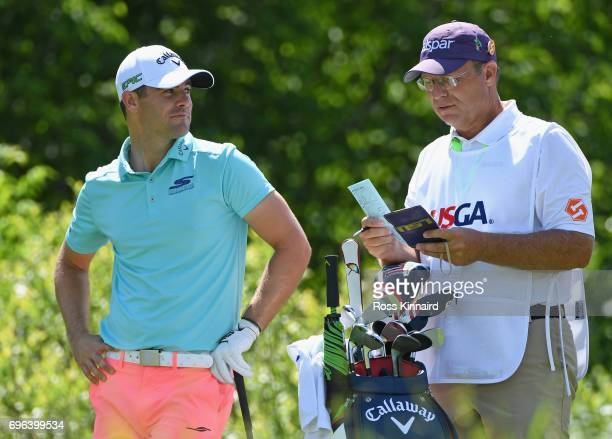 Wesley Bryan of the United States prepares to tee off on the 16th hole during the first round of the 2017 US Open at Erin Hills on June 15 2017 in...
