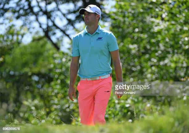 Wesley Bryan of the United States walks off the 16th tee during the first round of the 2017 US Open at Erin Hills on June 15 2017 in Hartford...