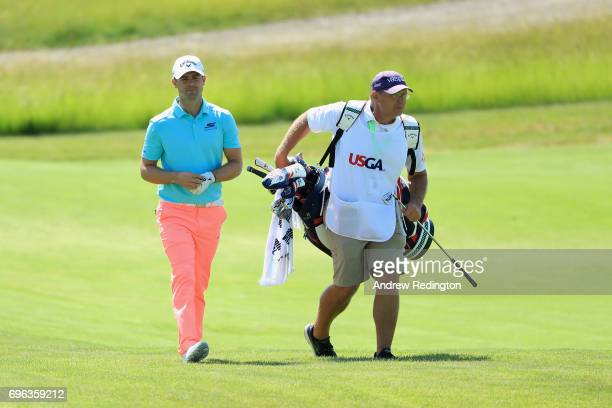 Wesley Bryan of the United States walks to the 17th green during the first round of the 2017 US Open at Erin Hills on June 15 2017 in Hartford...