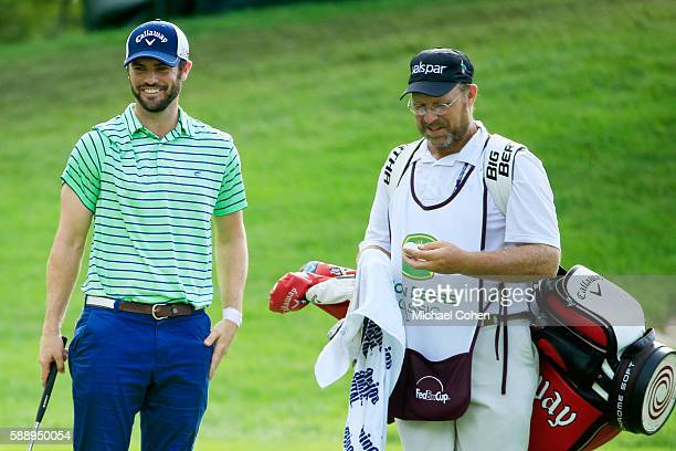 Wesley Bryan walks with his caddie on the first hole during the second round of the John Deere Classic at TPC Deere Run on August 12 2016 in Silvis...