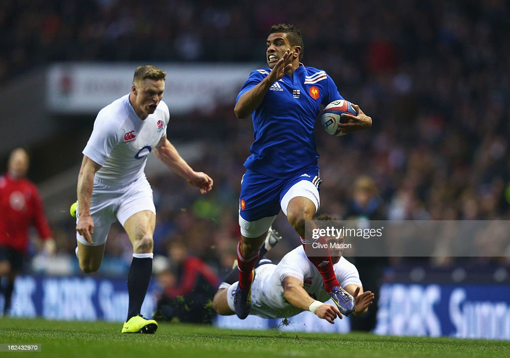 Wesley Fofana of France breaks away from <a gi-track='captionPersonalityLinkClicked' href=/galleries/search?phrase=Chris+Ashton&family=editorial&specificpeople=2649431 ng-click='$event.stopPropagation()'>Chris Ashton</a> and <a gi-track='captionPersonalityLinkClicked' href=/galleries/search?phrase=Ben+Youngs&family=editorial&specificpeople=3970947 ng-click='$event.stopPropagation()'>Ben Youngs</a> of England to score a try during the RBS Six Nations match between England and France at Twickenham Stadium on February 23, 2013 in London, England.