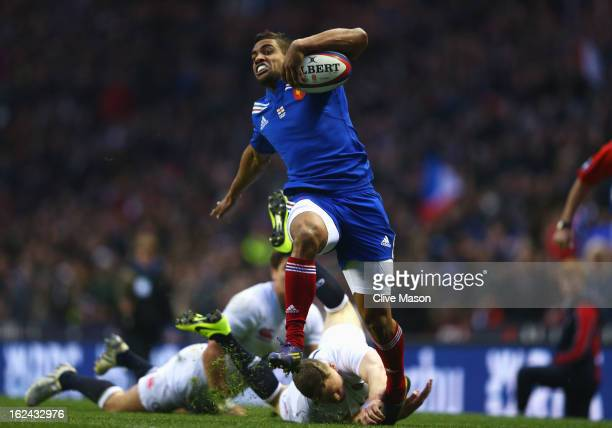 Wesley Fofana of France breaks away from Chris Ashton and Ben Youngs of England to score a try during the RBS Six Nations match between England and...