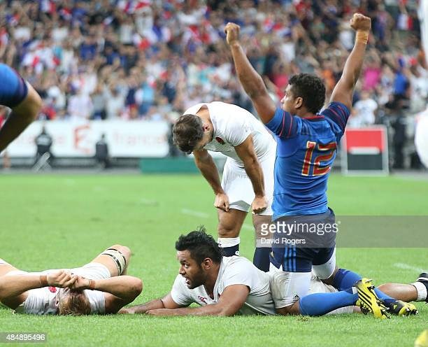 Wesley Fofana of France celebrates as England's Billy Vunipola looks dejected after the French victory during the International match between France...