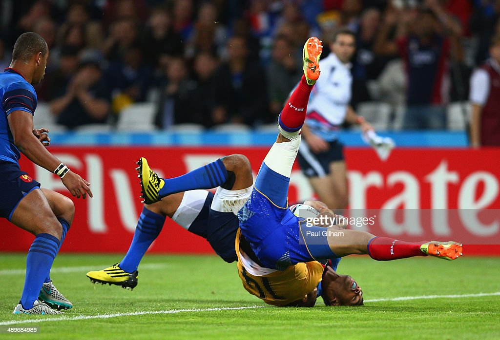 Wesley Fofana of France scores his teams fourth try as he is tackled by Madalin Lemnaru of Romania during the 2015 Rugby World Cup Pool D match between France and Romania at the Olympic Stadium on September 23, 2015 in London, United Kingdom.