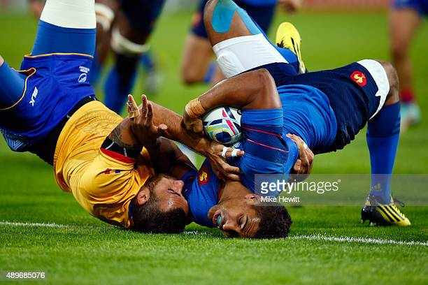 Wesley Fofana of France scores his teams fourth try as he is tackled by Madalin Lemnaru of Romania during the 2015 Rugby World Cup Pool D match...