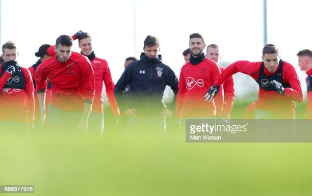 Wesley Hoedt and Jan Bednarek as players watch on during a Southampton FC training session at the Staplewood Campus on December 8 2017 in Southampton...