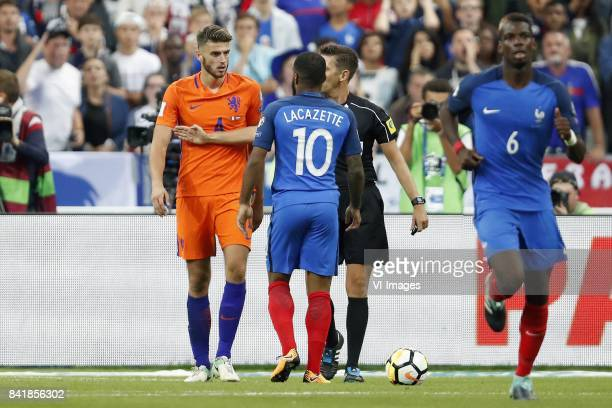 Wesley Hoedt of Holland Alexandre Lacazette of France referee Gianluca Rocchi Paul Pogba of France during the FIFA World Cup 2018 qualifying match...