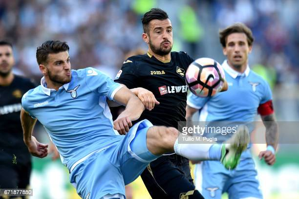 Wesley Hoedt of Lazio and Ilija Nestorovski of Palermo compete for the ball during the Serie A match between SS Lazio and US Citta di Palermo at...